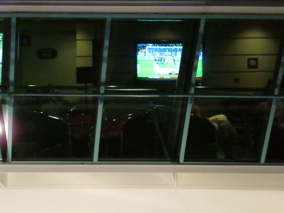 Playing peekaboo on the Monarch Viking Crown lounge, soccer is on