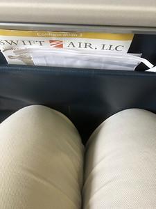 """""""Swift Airlines"""" leg room [MaryAnne's legs]"""