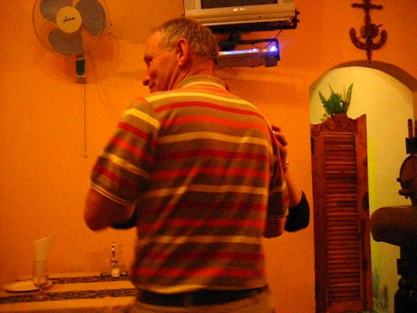 Jans dancing the salsa with the lady of the restaurant
