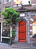 Very cute red door. I believe this is the side entrance to the Best Western Dam Square Inn.