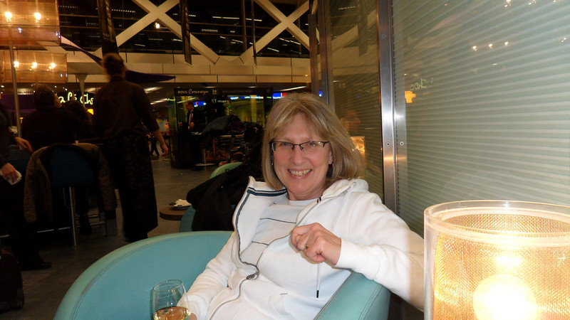 Marilyn enjoying chardonney and sushi at Schiphol Airport in Amsterdam as we wait for our flight to Nuremberg.