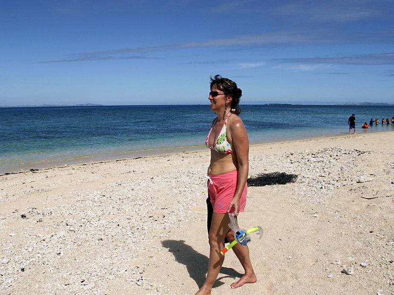 Lauray walking on Snorkel Island beach.
