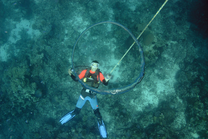 Tyrone Valentine blows bubble rings during his safety stop while guiding dives in the Somo Somo Strait.
