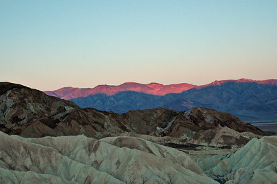 Sunrise over the Panamint Mtns from Zabriskie Point.