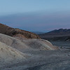 Sunrise on Zabriskie Point with a photographer visible on the trail getting ready to get his shot!
