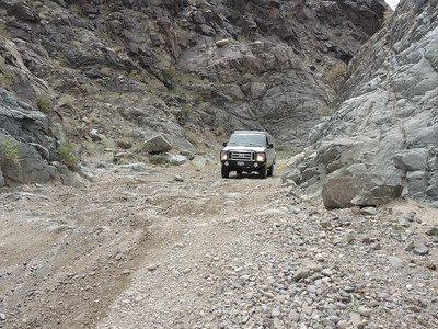 Joe drives up the Goler Wash step, 1 of 3.  03-18, photo by Sherry.