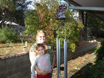 Kathy & Layah with wind chime. Happy Birthday! from Sean.