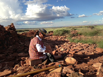Atop Citadel Ruin in Wupatki National Monument. Beautiful clouds. Michèle seemed at home in this landscape. Didgeridoo in foreground.
