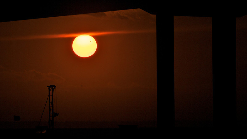 The spot on the sun is Venus crossing.  This was taken on the back of the Southern Star just after it went under the bridge over the Destin Harbor.