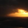 Sunrise through storm clouds.