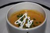Renee's starter:<br /> Creamy Butternut Squash Soup<br /> Garnished with Chives and drizzled with Sour Cream