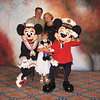 Mom, Dad and Faith hamming it up with the big Cheeses!!! <br /> <br /> Mickey and Minnie Mouse were adorned in Nautical attire this day!