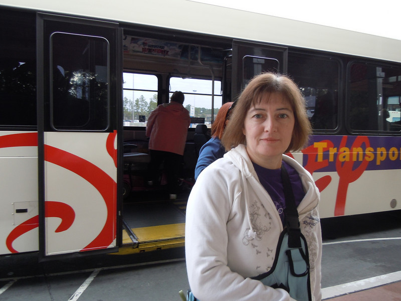 Susan getting on a bus to Epcot  from the Animal Kingdom lodge. It was in the 50-60's this AM.