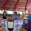 Sarah looking terrified on the teacups (and Wayne spinning as fast as possible)
