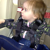 Emma on plane with her special buckle