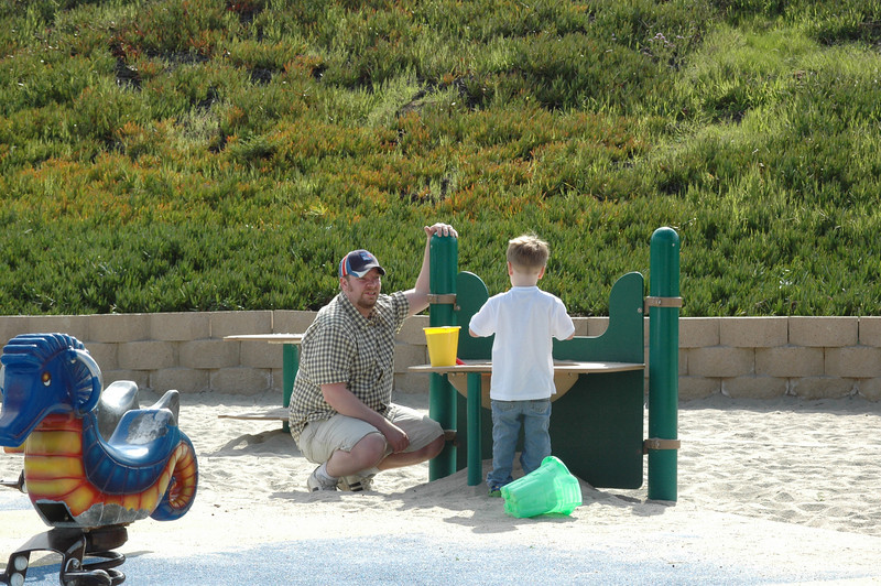 Playing in the sand, something Mom doesn't normally allow.