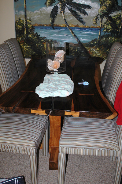 The dining area of the condo (what a table!)