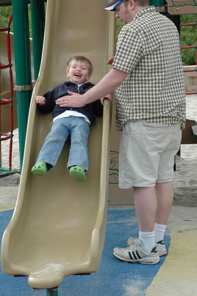 Chandler sliding down the slide.