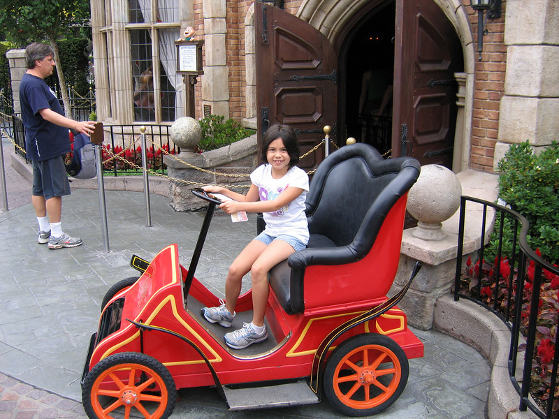 Heather is a Mr. Toad's Wild Ride car outside the ride
