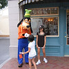 Heather and Evelyn saying hi to Goofy