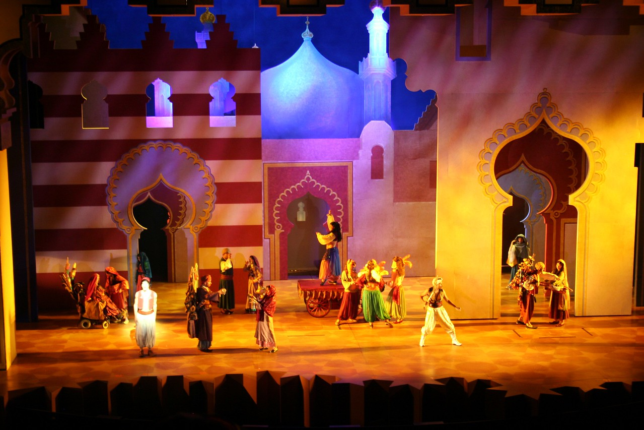 The production is a Broadway-type show. Many of the classic scenes and songs from the movie are re-created on stage and some of the action even spills out into the aisles, like Prince Ali's jubilant arrival in Agrabah on elephant back. Flying carpets, magic lamps, wise-cracking genies, princesses, and evil wizards - are all a part of this musical production.   This 45 minute production takes place in the 2,000 seat Hyperion Theater, located at the end of Hollywood Blvd. The exterior has design features reminiscent of many classic theaters.