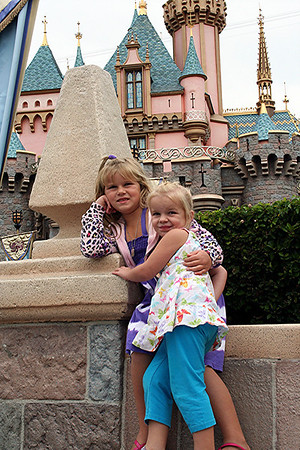 Anissa & Makenna let me take their picture in front of Sleeping Beauty's Castle