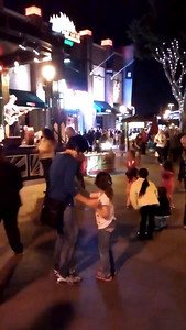 Kaitlin and Kathy dancing in downtown disney