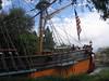 Sailing Ship hoisting flag