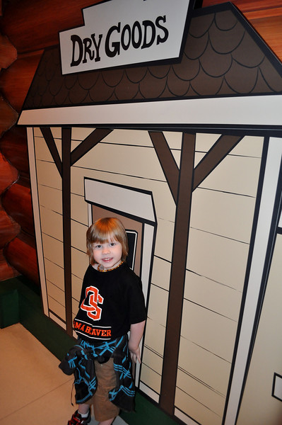 Lincoln posing inside Toy Story Mania.