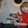 Ready to ride the plane! No clue where he's going!