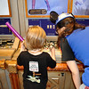 Lincoln working on his Lightsaber (purple-like Windoo).