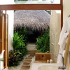 "the outdoor bathroom, leading to the bathtub ""hut"""
