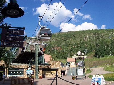 The two gondolas in Telluride Mountain Village. The one in front is a transportation gondola between the parking area and other parts of the mountain village. In the back is the gondola that goes over the mountain to the town of Telluride.