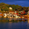 Sunsetting Bay: Prince Edward Island; A light rain shower passing over and into the background, when sunlight burst through a hole in the clouds and illuminated this perfect, tiny fishing village during the golden hour.