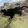 Around the coast are several hundred lava tubes or caves formed during volcanic eruptions by low viscosity molten lava.  There is evidence that the caves were used extensively as refuges.  Many have man-made entrances.  This one is Ana Kai Tangata.