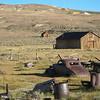 Abandoned car & other debris