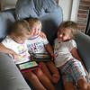 Three sweeties using Kindles