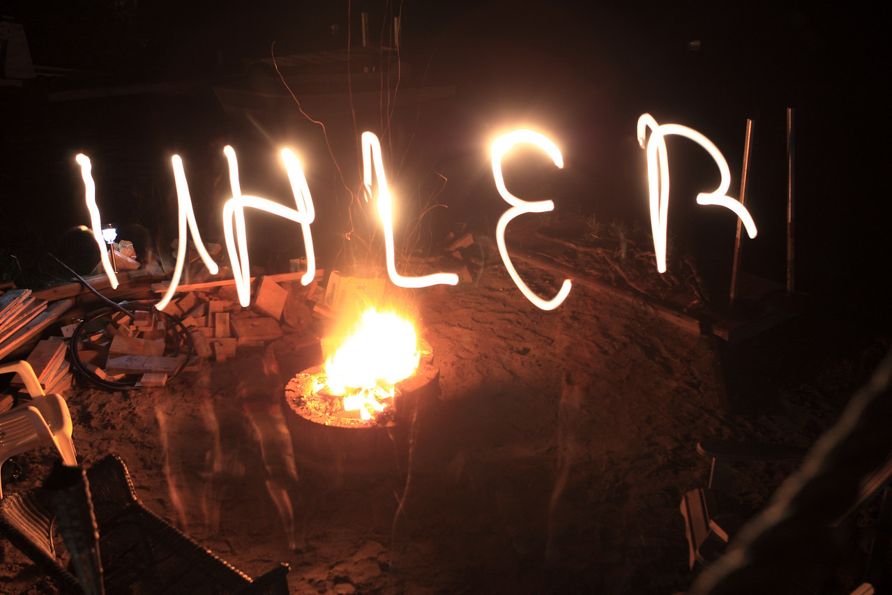 A longer exposure of the camp fire, while Uhler writes his name in the air with a flashlight.