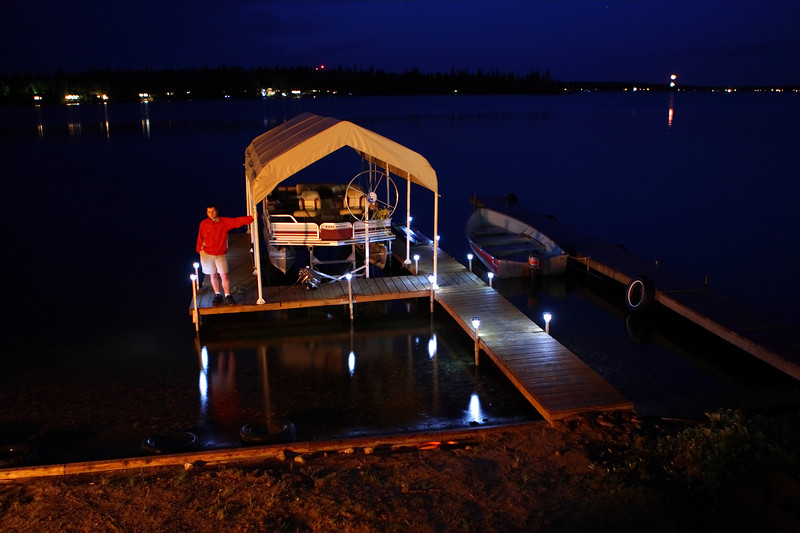 A 30 second exposure with me standing nearly motionless. Have a look at the original size picture and look above the boat shelter. You'll see a meteor, and to the right some fireworks. It's slightly out of focus, but hey, I can't be perfect.