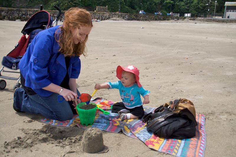 Jessica and Eve work on making sand castles on Looe beach