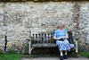 Young Lady sitting on Arlington Row in Bibury