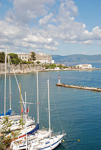 Sail boats docked at Old Fort on Ionian Sea in Corfu