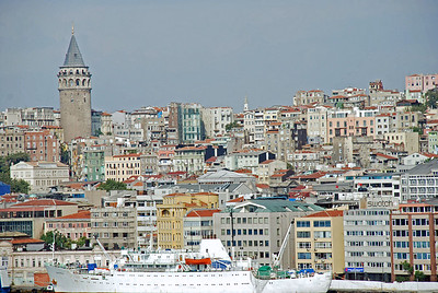 Galata Tower as right is an ancient bastion of a fortified wall