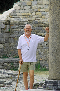 Bill pushing over a pillar at ruins in Solin