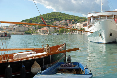 Boats docked on river near Trogir