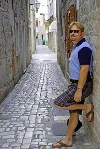 Wes in narrow path in ancient walled city of Trogir, Croatia
