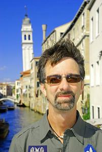 Jerry on bridge over Rio dei Greci with San Giorgia dei Greci in background