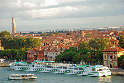City view of Venice with dinner boat in foreground