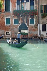 Gondola Navigates One of many Narrow Canals