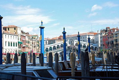 City government boats on Grand Canal in view of Rialto Bridge